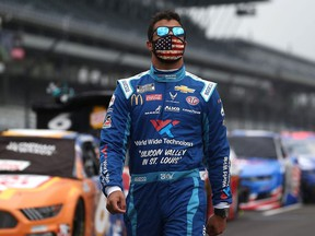 Bubba Wallace, driver of the #43 World Wide Technology Chevrolet, walks the grid prior to the NASCAR Cup Series Big Machine Hand Sanitizer 400 Powered by Big Machine Records at Indianapolis Motor Speedway on July 05, 2020 in Indianapolis, Indiana.