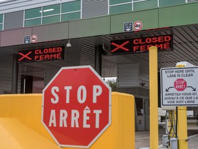 "Two closed Canadian border checkpoints are seen after it was announced that the border would close to ""non-essential traffic""  to combat the spread of novel coronavirus disease at the U.S.-Canada border crossing at the Thousand Islands Bridge in Lansdowne, Ont., March 19, 2020."