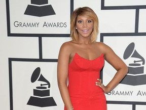 Tamar Braxton arrives on the red carpet for the 56th Grammy Awards at the Staples Center in Los Angeles, California, January 26, 2014.