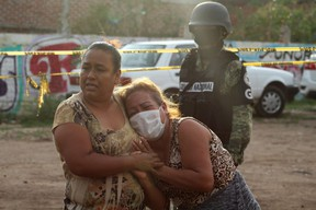 Women react outside a drug rehabilitation facility where assailants killed several people, according to Guanajuato state police, in Irapuato, Mexico July 1, 2020.