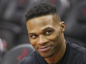 Houston Rockets guard Russell Westbrook (0) smiles during warmups before playing against the Phoenix Suns at Toyota Center.