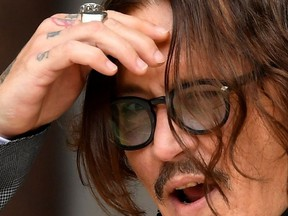 Actor Johnny Depp reacts as he arrives at the High Court in London, Britain July 13, 2020.