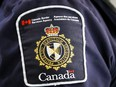 A Canada Border Services Agency patch is seen on an officer in Calgary, Alta., Thursday, Aug. 1, 2019