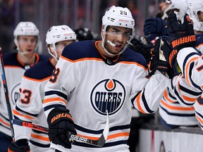 Edmonton Oilers forward Andreas Athanasiou celebrates his goal with the bench to tie the game 3-3 with the Anaheim Ducks during the third period in a 4-3 overtime Ducks win at Honda Center on Feb. 25, 2020, in Anaheim, Calif.