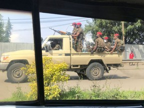 Ethiopian military ride on their pick-up truck as they patrol the streets following protests in Addis Ababa, Ethiopia July 2, 2020.