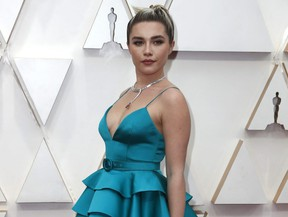 Florence Pugh poses on the red carpet during arrival at the 92nd Academy Awards in Hollywood February 9, 2020.