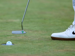 A view of the logo on the putter of Tony Finau as he putts on the 18th green during the final round of The Memorial Tournament at Muirfield Village Golf Club.