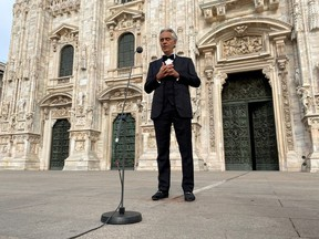Italian opera singer Andrea Bocelli rehearses in an empty Duomo square on Easter Sunday ahead of a livestreamed concert for the event ''Music for hope'', inside the empty Duomo cathedral, which is intended as a symbol of love, hope and healing amidst the coronavirus disease (COVID-19) outbreak, in Milan, Italy, April 12, 2020.