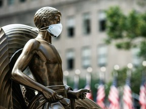 The Mankind Figure of Youth statue at Rockefeller Center in Manhattan is seen adorned with a face mask following the outbreak of the coronavirus disease (COVID-19), in New York City, New York, U.S., July 5, 2020.