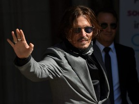 Johnny Depp arrives at the Royal Courts of Justice, the Strand, in London, England, on Tuesday, July 28, 2020.