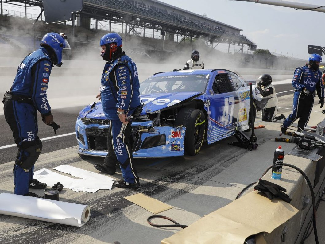 Crazy pit road wreck injures tire changer during Indy NASCAR race