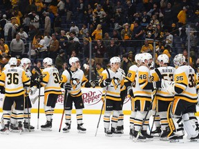 Pittsburgh Penguins goaltender Tristan Jarry (35) is congratulated by teammates after a win against the Nashville Predators at Bridgestone Arena.