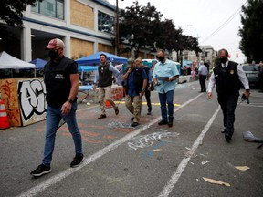 Members of the Seattle Police homicide unit leave the scene of a fatal shooting in the Capitol Hill Organized Protest area as people occupy space in the aftermath of the death in Minneapolis police custody of George Floyd, in Seattle, June 29, 2020.