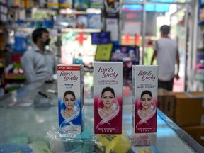 """This photo taken on July 8, 2020 shows packages of Unilever """"Fair and Lovely"""" skin-lightening creams on the counter of a shop in New Delhi."""