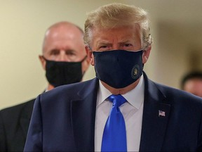 President Donald Trump wears a mask while visiting Walter Reed National Military Medical Center in Bethesda, Maryland July 11, 2020.