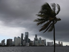Storm clouds are seen over the city as Hurricane Isaias approaches the east coast of Florida on Aug. 1, 2020 in Miami.