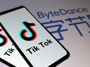 TikTok logos are seen on smartphones in front of a displayed ByteDance logo in this illustration taken Nov. 27, 2019.