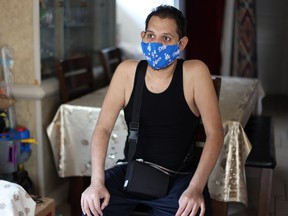 Francisco Garcia, 31, who spent almost four months in hospital with coronavirus disease, recovers at his home in Los Angeles, Calif., Aug. 19, 2020.