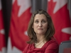 CP-Web.  Deputy Prime Minister and Minister of Intergovernmental Affairs Chrystia Freeland looks at a projected graphic during a news conference in Ottawa, Monday April 6, 2020. THE CANADIAN PRESS/Adrian Wyld ORG XMIT: ajw102