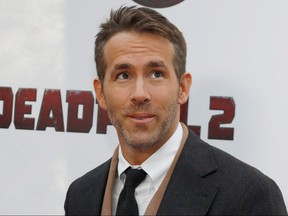 """Actor Ryan Reynolds poses on the red carpet during the premiere of """"Deadpool 2"""" in Manhattan, N.Y., May 14, 2018."""