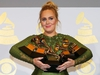 """FILE PHOTO: Adele holds the five Grammys she won including Record of the Year for """"Hello"""" and Album of the Year for """"25"""" during the 59th Annual Grammy Awards in Los Angeles, California, U.S. , February 12, 2017. REUTERS/Mike Blake/File Photo ORG XMIT: FW1"""