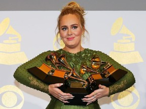 """Adele holds the five Grammys she won including Record of the Year for """"Hello"""" and Album of the Year for """"25"""" during the 59th Annual Grammy Awards in Los Angeles, California, U.S. , February 12, 2017."""