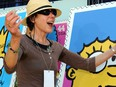 Actress Julie Kavner (voice of Marge Simpson) poses next to the unveiled stamps of Simpsons characters at the Fox Studios in Los Angeles, California, on May 7, 2009, during a dedication ceremony for the first day of issue of the stamps by the US Postal Service.