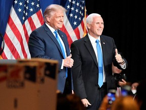 President Donald J. Trump and Vice President Mike R. Pence react at the Republican National Convention at the Republican National Convention in Charlotte, North Carolina, U.S., August 24, 2020.