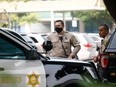 Los Angeles County Sheriff's Department deputies stand outside St. Francis Medical Center following the ambush shooting of two deputies in Compton, in Lynwood, California September 13, 2020.
