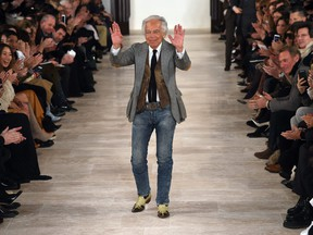Designer Ralph Lauren greets the audience after presenting his creations during the Fall 2016 New York Fashion Week on Feb. 18, 2016, in New York.