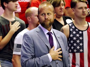 Brad Parscale, Trump 2020 re-election campaign manager, stands for the national anthem as U.S. President Donald Trump rallies with supporters in Southaven, Mississippi, October 2, 2018.