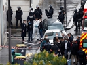 Police officers investigate the scene of an incident near the former offices of French magazine Charlie Hebdo, in Paris, France September 25, 2020. REUTERS/Gonzalo Fuentes ORG XMIT: GDN