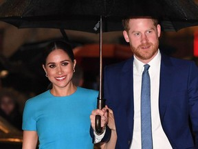 In this file photo taken on March 5, 2020 Britain's Prince Harry, Duke of Sussex (R) and Meghan, Duchess of Sussex arrive to attend the Endeavour Fund Awards at Mansion House in London.