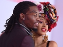 In this file photo taken on October 9, 2018 US rapper Cardi B and US rapper Offset arrive at the 2018 American Music Awards in Los Angeles, California.