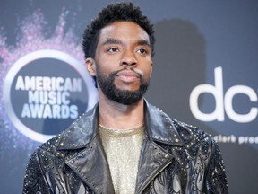Chadwick Boseman poses backstage at the American Music Awards in L.A. Nov. 24, 2019.