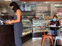 In this file photo, customers are seen inside a bakery as Miami-Dade county allows indoor servicing in restaurants after easing some lockdown measures put in place during the coronavirus outbreak, in Miami, Florida, Aug. 31, 2020.