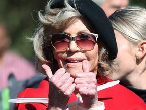 """Actress Jane Fonda is arrested for blocking a street in front of the U.S. Capitol during a """"Fire Drill Fridays"""" climate change protest and rally on Capitol Hill, Oct. 18, 2019 in Washington, D.C."""
