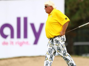 John Daly walks on the 18th green during the second round of the Ally Challenge at Warwick Hills Golf & Country Club on August 1, 2020 in Grand Blanc, Michigan.