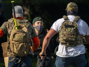 Right wing demonstrators chase a Black Lives Matter protester after a pro-Trump caravan rally convened at the Oregon State Capitol building on September 7, 2020 in Salem, Oregon.