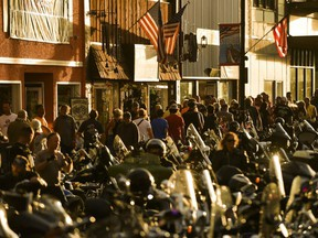 People walk along Main Street during the 80th Annual Sturgis Motorcycle Rally in Sturgis, South Dakota, Aug. 8, 2020.