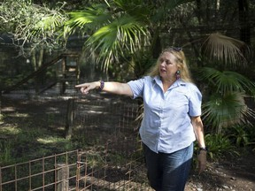 In this July 20, 2017, file photo, Carole Baskin, founder of Big Cat Rescue, walks the property near Tampa, Fla.