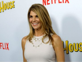 """Cast member Lori Loughlin poses at the premiere for the Netflix television series """"Fuller House"""" at The Grove in Los Angeles, California, U.S., February 16, 2016."""
