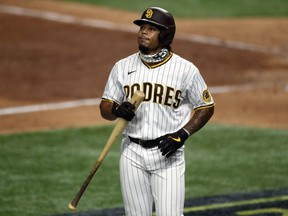 Luis Campusano of the San Diego Padres reacts after striking out during the eighth inning against the Los Angeles Dodgers in Game Three of the National League Division Series at Globe Life Field on October 08, 2020 in Arlington, Texas.