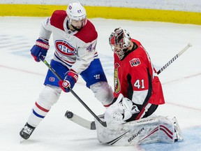 Ottawa Senators goaltender Craig Anderson (41) makes a save against Montreal Canadiens center Nate Thompson (44) during NHL action at the Canadian Tire Centre in Ottawa on Saturday February 22, 2020.