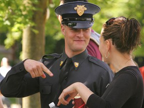 Actor Zachery Ty Bryan of Home Improvement fame chats with an unidentified woman on the set of Codebreakers, a made for TV movie being filmed in London, Ont.