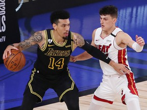 Danny Green of the Los Angeles Lakers drives the ball against Tyler Herro of the Miami Heat during Game 5 of the 2020 NBA Finals at AdventHealth Arena at the ESPN Wide World Of Sports Complex on October 9, 2020 in Lake Buena Vista, Florida.