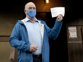 B.C. NDP Leader John Horgan arrives at Luxton Hall to cast his vote in advance polls for the provincial election in Langford, B.C., Monday, Oct. 19, 2020.