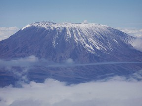 A fresh dusting of snow sits atop the dormant volcano of Mount Kilimanjaro, Africa's highest peak, in northern Tanzania, November 22, 2007.