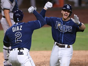 Tampa Bay Rays first baseman Michael Brosseau (43) celebrates with designated hitter Yandy Diaz (2) after hitting a home run against the New York Yankees at Petco Park.