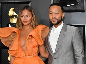 Chrissy Teigen and John Legend attend the 62nd Annual Grammy  Awards at Staples Center on January 26, 2020 in Los Angeles.